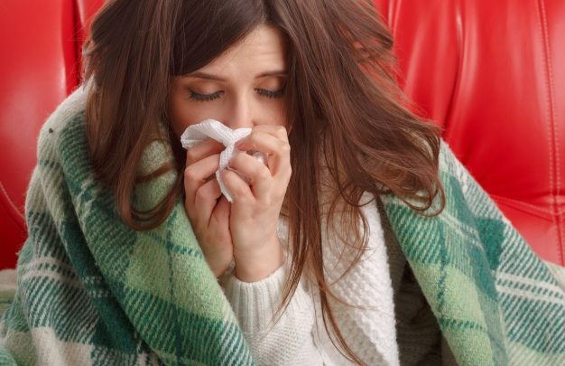 ill teenager with a tissue بیماری